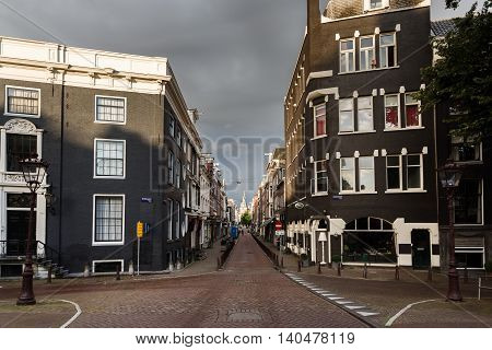 Amsterdam Netherlands - July 03 2016: Traditional Dutch houses on a deserted Keizersgracht street in Amsterdam