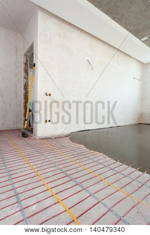 Electric floor heating system installation in new house.