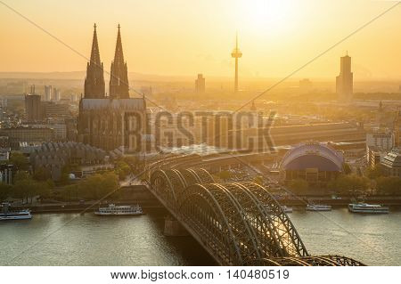 Image of Cologne with Cologne Cathedral and Rhine river during sunset in Cologne Germany.