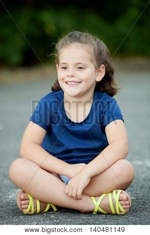 Cute little girl in a summer day with blue t-shirt
