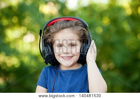 Little girl with headphones on a park