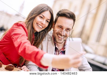 Cropped shot of an affectionate young couple taking a selfie.They are enjoying together and having a great time.