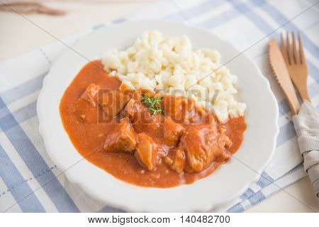 Traditional Hungarian hot goulash soup in a bowl