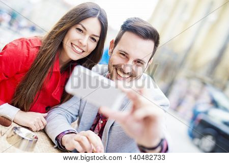 Happy couple taking a selfie.Cropped shot of an affectionate young couple taking a selfie.