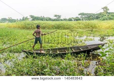 Little Child Is Standing In A Boat