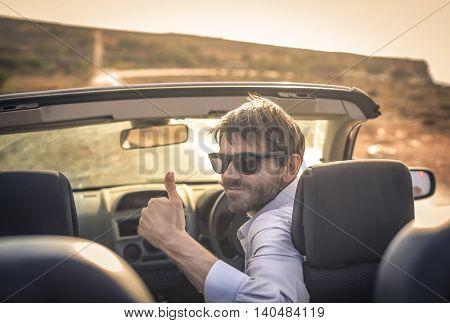 Man driving his convertible car