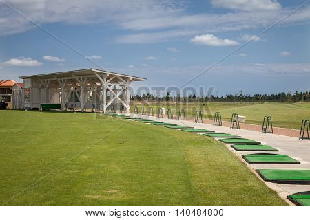 Golf course driving range, blue cloudy sky