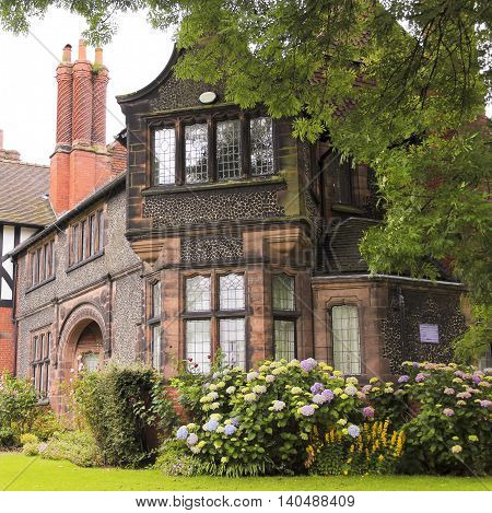 PORT SUNLIGHT, ENGLAND, JUNE 29. The Bridge Cottage on June 29, 2016, in Port Sunlight, England. The historic Bridge Cottage in Port Sunlight England.