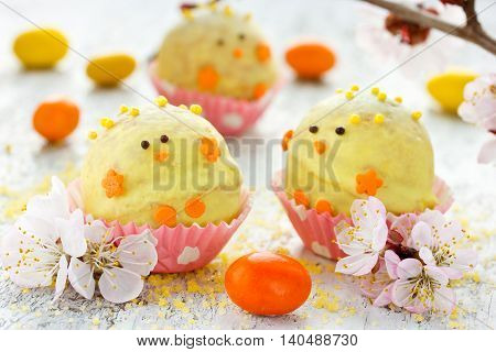 Festive Easter chicken candy mini ball. Fun idea for kids party selective focus