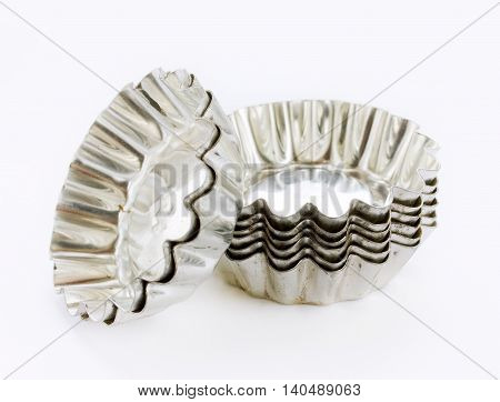 Metallic tins for tartlet isolated on white background