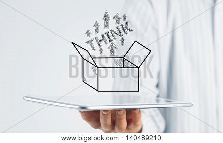 Hand of businessman holding tablet pc with creativity concept