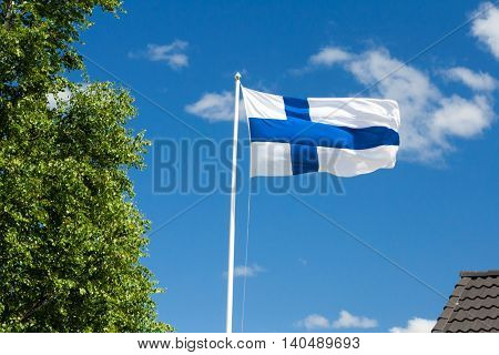 Flag of Finland on blue sky background.