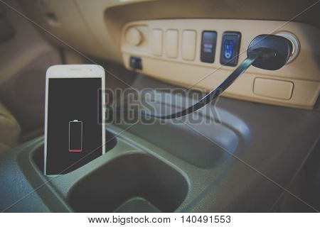blurred Image smart phone Charger plug phone on car