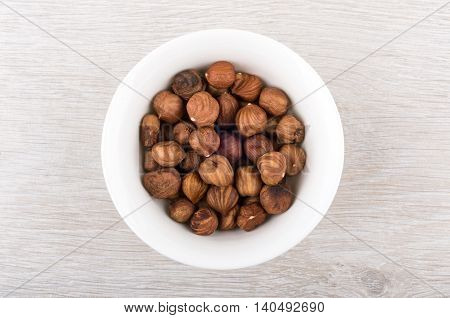 Hazelnuts In Small Glass Bowl On Table