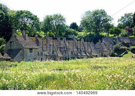 BIBURY, UNITED KINGDOM - JULY 20, 2016 - View of the Arlington Row cottages Bibury Cotswolds Gloucestershire England UK Western Europe, July 20, 2016.