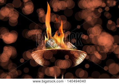 conceptual image of burning money pile.