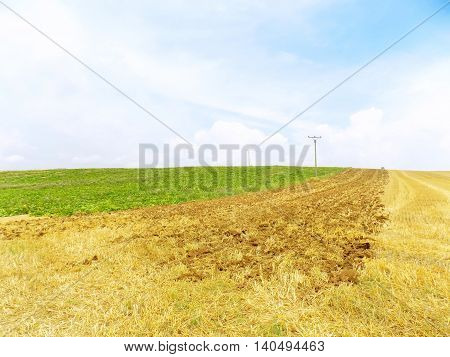 Three different fields - field after harvest, plowed field and green field