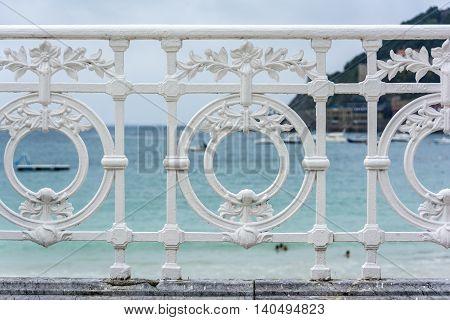 Famous ornamental iron fence in La Concha beach, San Sebastian. Guipuzcoa, Basque Country, Spain