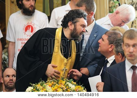Orel Russia - July 28 2016: Russia baptism anniversary Divine Liturgy. Vadim Potomsky Orel city governor talking to bishop in orthodox church