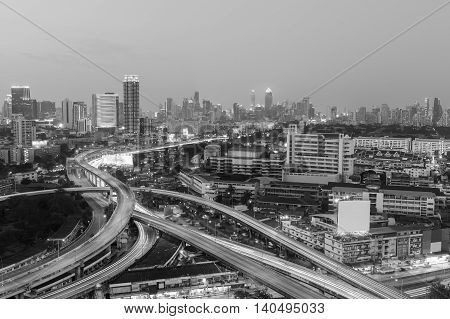 Black and White, Highway interchanged with office building downtown background