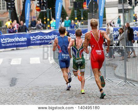 STOCKHOLM - JUL 02 2016: Rear view of running triathletes Schomburg Schoeman Blummenfelt in the Men's ITU World Triathlon series event July 02 2016 in Stockholm Sweden