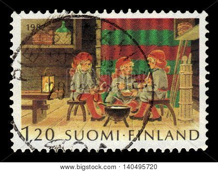 FINLAND - CIRCA 1982: a stamp printed in Finland shows Christmas dwarfs eating, series Christmas, circa 1982