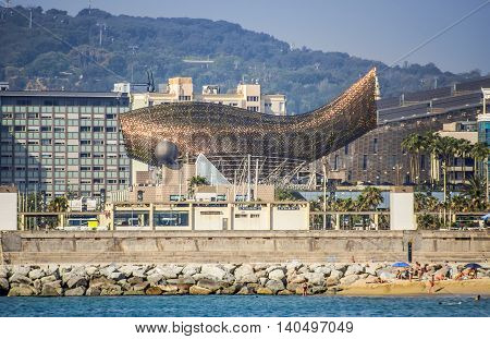 BARCELONA SPAIN - JULY 2 2016: Frank Gehry's modern El Peix d'Or sculpture is located in Barcelona's Vila Olimpica.