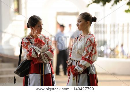 Orel Russia - July 28 2016: Russia baptism anniversary Divine Liturgy. Two girls in traditional Russian clothes horizontal