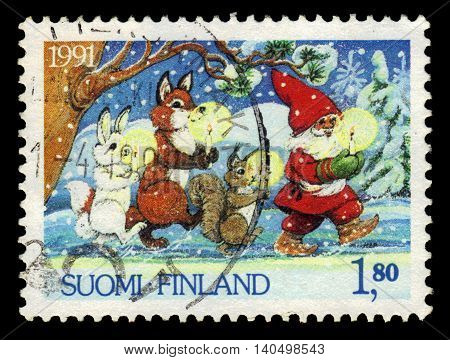 FINLAND - CIRCA 1991: a stamp printed in Finland shows Santa Claus and animals with candles, series Christmas, circa 1991
