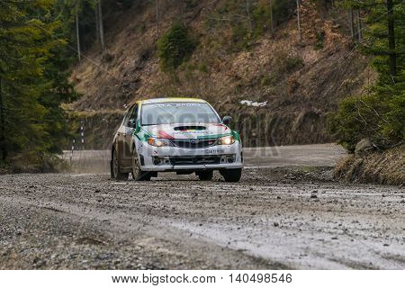 Nyzni Worota Ukraine - March 13 2016: Unknown racer on the car brand Subaru Impreza overcome the track at the annual Rally of Winter peaks near the city of Nyzni Worota Ukraine