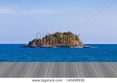 Opening wooden floor, Small lonely island over seacoast skyline, natural landscape background