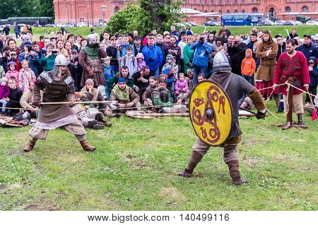SAINT-PETERSBURG RUSSIA - MAY 28: Medieval battle reconstruction in Peter and Paul Fortress at May 28 2016 in Saint-Petersburg Russia