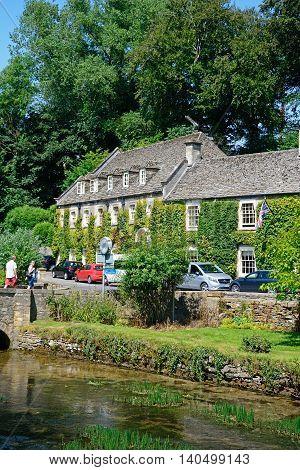 BIBURY, UNITED KINGDOM - JULY 20, 2016 - View across the River Coln towards The Swan Hotel Bibury Cotswolds Gloucestershire England UK Western Europe, July 20, 2016.