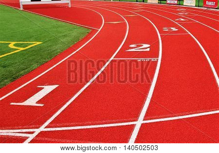 Track and Fields 200 meter start line on a red track with the steeple in the background