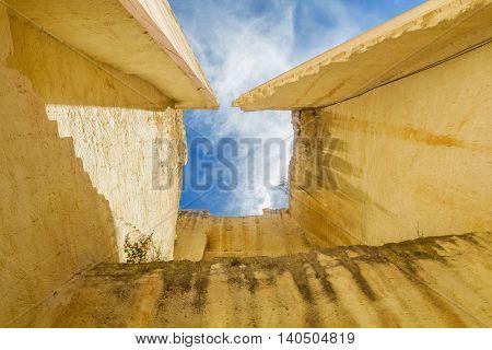 Lithica Pedreres des Hostal old quarry sandstone high walls at Menorca island, Balearic islands, Spain.