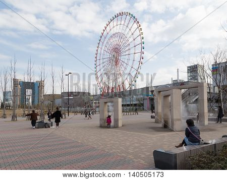 Tokyo - 7 February 2015: Beautiful fashionable district of Tokyo - Odaiba and a beautiful park and people walk in good weather 7 February Tokyo Japan