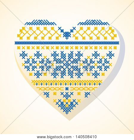 Vector illustration of a creative symbol of heart in the form of ethnic hand-made embroidery in blue and yellow colors. National Ukrainian stylized pattern and ornament