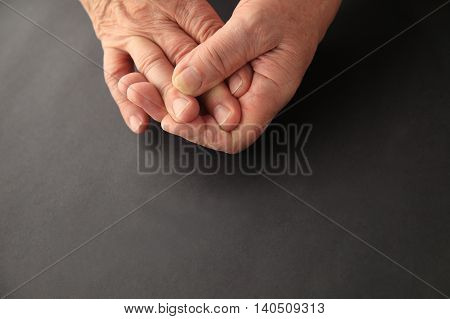 Man's hands on black background with copy space