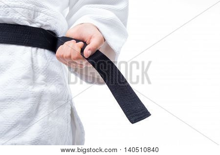 Close up of judo judo-gi and black belt isolated on white background
