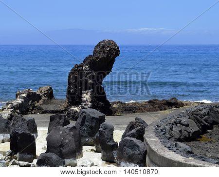 Playa De Las Americas beach volcanic rock in Tenerife