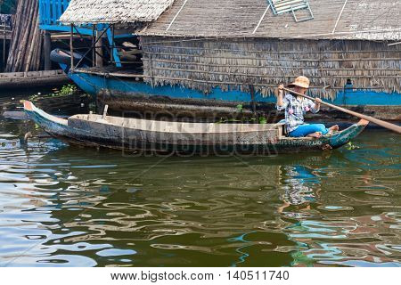 SIEM REAP, CAMBODIA-NOVEMBER 17, 2011: An unidentified girl on a boat floating on Tonle Sap lake in Siem Reap. Tonle Sap is the largest lake in SE Asia peaking at 16kkm2