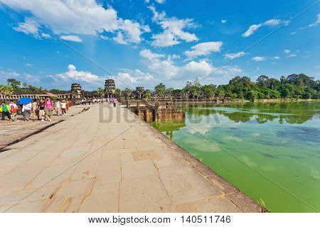 SIEM REAP, CAMBODIA - NOVEMBER 15, 2011:  Bridge to Angkor wat temple. Angkor Wat is a Hindu, then subsequently Buddhist temple complex and the largest religious monument in the world.
