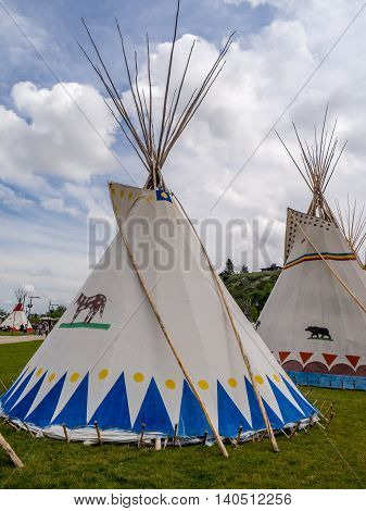 CALGARY, CANADA - JULY 9: View of Tipis in the Indian Village at the Calgary Stampede on July 9, 2016 in Calgary, Alberta. The Indian Village represents First Nations people at the Calgary Stampede.