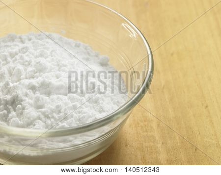 bowl of baking soda on the wooden background