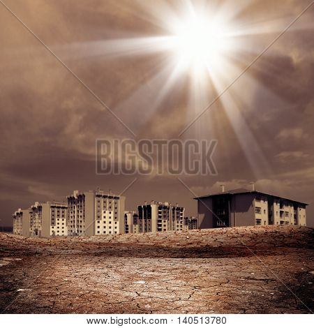 conceptual shot of buildings on dried and cracked landscape.