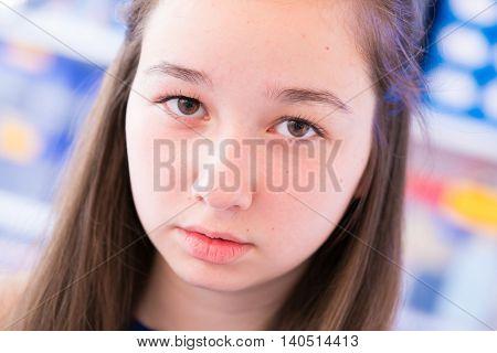Portrait of sad teen school girl