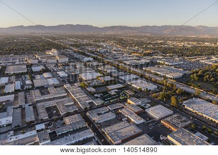 Late afternoon aerial above Van Nuys in the San Fernando Valley area of Los Angeles, California.