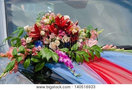 Wedding car decoration with flowers and ribbons