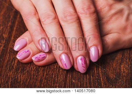 Light Pink Nail Art On Wooden Background