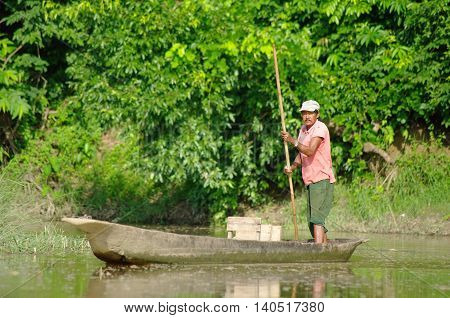 Manaus, Br, Circa August 2011 - Man On A Canoe On The Amazon River, Circa August 2012 At Manaus, Br.